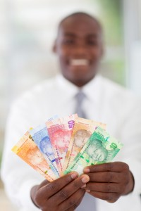 young south african businessman holding new bank notes